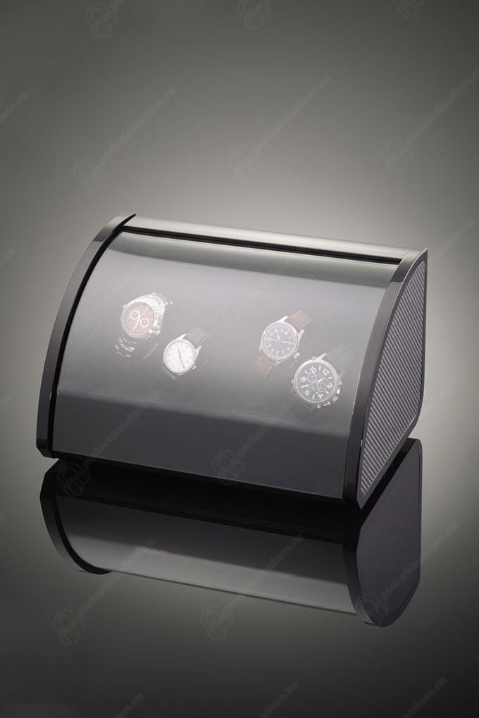 ELMA motion 1038249 Шкатулка для 4 наручных часов. Черная полированная, отделка карбон. Обеспечивает все типы подзавода: по часовой стрелке, против часовой стрелки и переменное вращение.