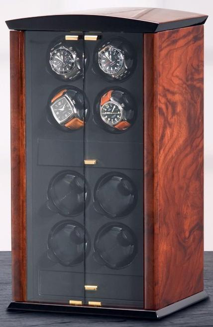 ELMA motion 100 97 71 Заводная шкатулка Elma Corona 8. Материал корпуса шкатулки, изготовлен из корня ореха. Она представляет собой, миниатюрный шкафчик для ваших часов. Стеклянные дверцы позволяют наблюдать за работой шкатулки и вашими часами.